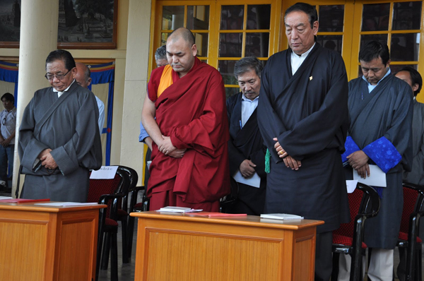 Officiating Sikyong Kalon Pema Chhinjor and Deputy Speaker Khenpo Sonam Tenphel take part in a minute's silence to express solidarity with and pray for all those Tibetans who have sacrificed their lives for the cause of Tibet