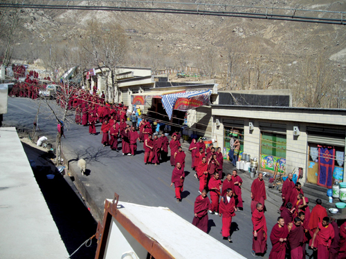 Monks from Drepung Monastery on a peaceful protest march towards Barkhor Street to mark the 49th anniversary of the Tibetan National Uprising against the Chinese invasion, Lhasa, 10 March 2008