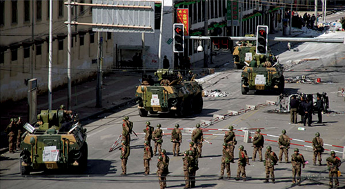 A de facto martial law was imposed in Lhasa, with streets filled with patrolling Chinese armed troops and tanks, security agencies searching houses in Lhasa and arresting all Tibetans suspected of being involved in the protests, 15 March 2008