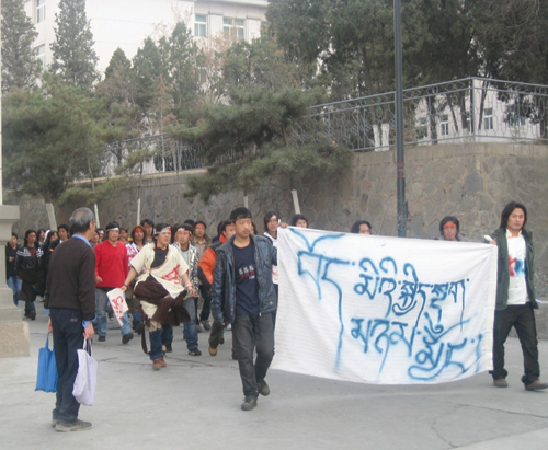 "Tibetan students from the Tibetan Studies Department, Northwestren Nationalities University, Lanzhou City, Gansu province, staged a protest within the campus ground, their banner reads "" Tibetan people united in happy and bad times"" and called for the end to Chinese Government,s violent crackdown on peaceful Tibetan demonstrators in all parts of Tibet, 16 March 2008"