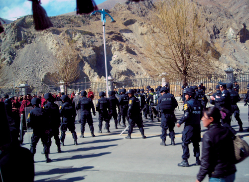 Chinese armed police blocked the protesting monks of Drepung Monastery by surrounding them on both sides of the road and blocked all road accesses to Drepung Monastery, Lhasa, 10 March 2008