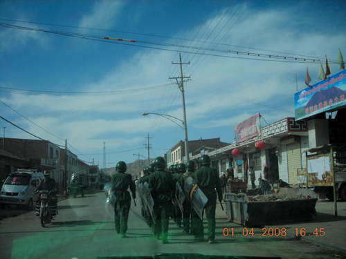 "Chinese security personnel patrolling the streets of Holkha township, Tsegor Thang County, tsolho ""TAP"", Qinghai Province, 1 April 2008"
