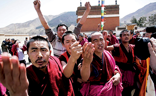 About 15 monks from Labrang Tashi-Khyil Monastery staged a protest in front of the Chinese government-controlled media tour, Sangchu County, Gansu Province, 9th April 2008