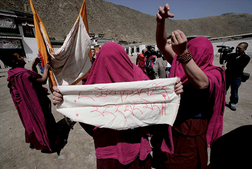 "The protesting monks approached the journalists by carrying the banned Tibetan National flag and banners that read: ""We have no freedom of speech."" The monks shouted, ""We want freedom, we want human rights, we want the Dalia Lama to return""' Labrang Tashi-khyil Monastery, Sangchu County, Gansu Province, 9th April 2008"