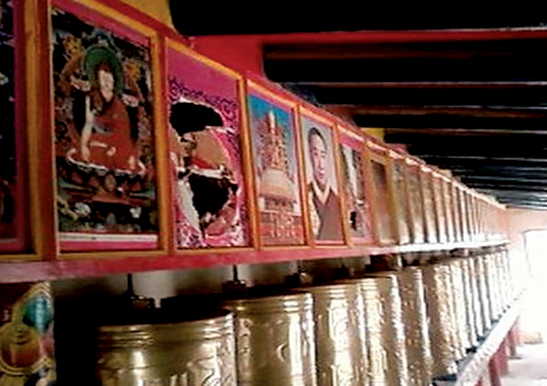 Portraits of His Holiness the Dalai Lama (point with arrow) in the prayer wheel house of Kirti Monastery destroyed by the Chinese police, 28 April 2008