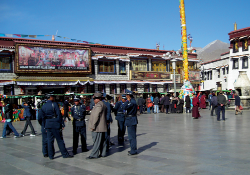 Chinese policemen in uniform and plain clothes keeping a close vigil in Lhasa streets, 10 March 2008