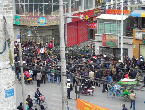 Several hundred armored personnel carriers and tanks were seen shooting live ammunition into the protesting crowd and firing tear gas. The Chinese security and armed forces cordoned off the streets and around 1:30 pm, curfew was imposed on the entire city, Lhasa, 14th March 2008