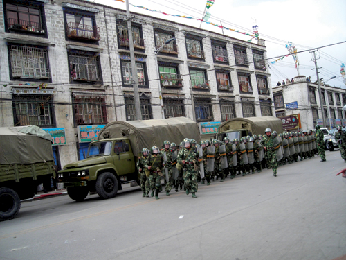 A large number of paramilitary forces were deployed in Lhasa and neighboring areas to suppress the peaceful protests by Tibetans. All the roads leading in and out of Lhasa were cordoned off and paramilitary forces patrolled the streets, 14th March 2008