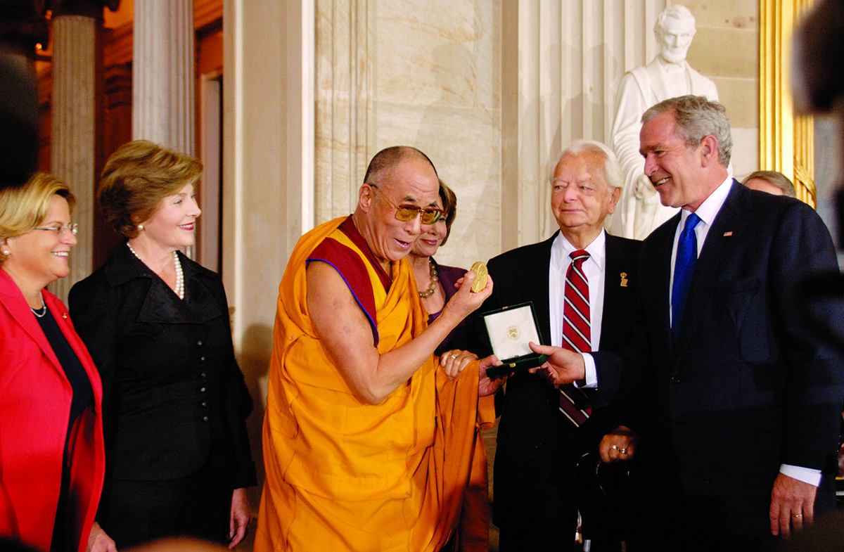 His Holiness the Dalai Lama receiving the US Congressional Gold Medal from US President George W. Bush at the Capitol Hill, Washington DC, 17 October 2007