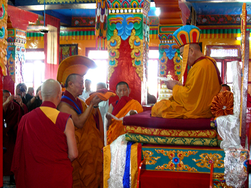 Kyabje Trizin Rinpoche of Tibet's oldest spiritual tradition, Bon, presenting a long-life prayer offering to Holiness the Dalai Lama at Menri-Ling Bonpo Monastery, Dolanji on 20 April 2007
