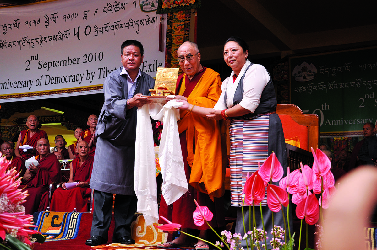 His Holiness the Dalai Lama being honoured with the Gold Medal by Speaker Penpa Tsering and Deputy Speaker Gyari Dolma of the Tibetan Parliament-in-Exile, Bylakuppee, Karnataka, 2 September 2010