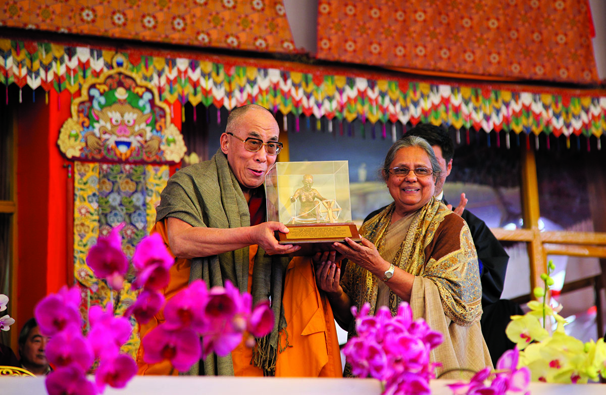 His Holiness the Dalai Lama being presented with the Mahatma Gandhi Peace and Reconciliation Award by Ms. Ela Gandhi, President of Gandhi Development Trust, South Africa, in Bodh Gaya, Bihar, 4 January 2012