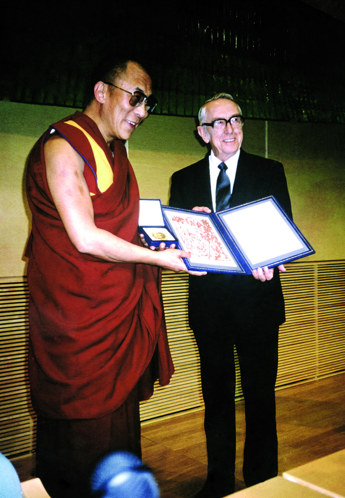 His Holiness the Dalai Lama receiving the Nobel Peace Prize from Mr. Egil Arvik, Chairman of the Norwegian Nobel Committee, Oslo, Norway, 10 December 1989