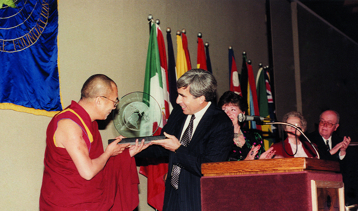 His Holiness the Dalai Lama accepting the Distinguished Peace Leadership Award from David Krieger, Executive Director, Nuclear Age Peace Foundation in Santa Barbara, California, US, 6 April 1991