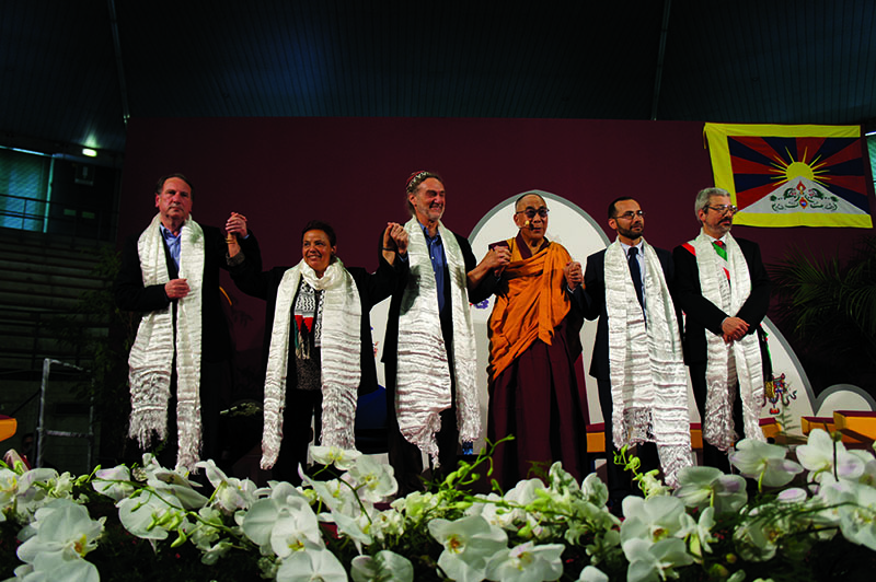 His Holiness the Dalai Lama and panelists of the discussion on the Role of Religions in Promoting Justice, Peace and the Protection of the Environment in Udine, Italy, 22 May 2012