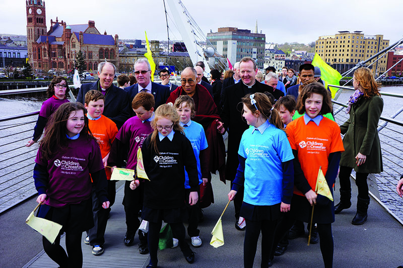 His Holiness the Dalai Lama and fellow participants crossing the Peace Bridge as part of the Children in Crossfire's Culture of Compassion event in Derry, Northern Ireland, April 18 2013