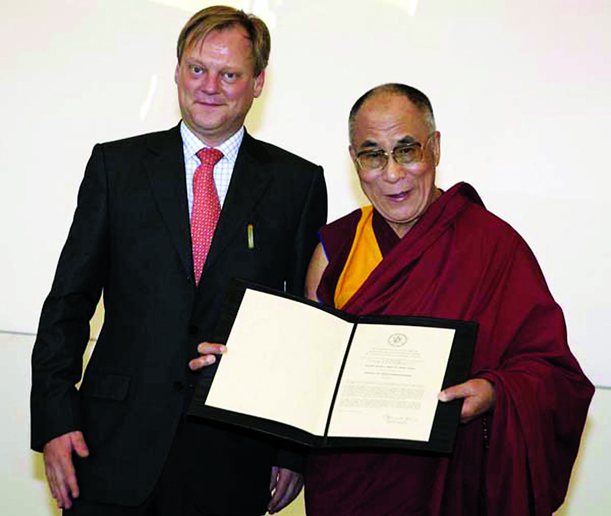 His Holiness the Dalai Lama receiving the University of Muenster's honorary doctorate degree in natural science, Germany, 20 September 2007