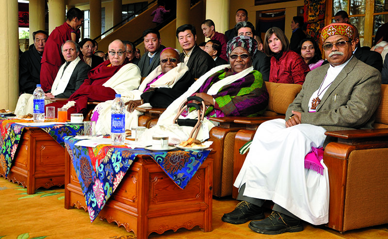 His Holiness the Dalai Lama with Nobel Peace laureate Archbishop Desmond Tutu and his wife during a felicitation ceremony held in Dharamshala, 10 February 2012