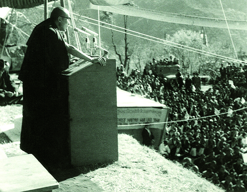 His Holiness the Dalai Lama addressing the public during Tibetan Democracy Day, Dharamshala, 1970
