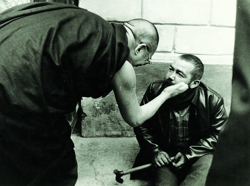 His Holiness the Dalai Lama meeting a homeless men during his visit to Prague, Czech Republic, 1990