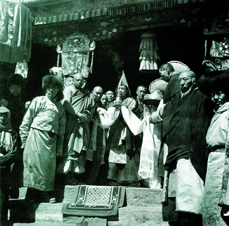 His Holiness the Dalai Lama receiving the Lord Buddh's Sacred Relics at Dungkar Monastery, Dromo (Yatung), 1951