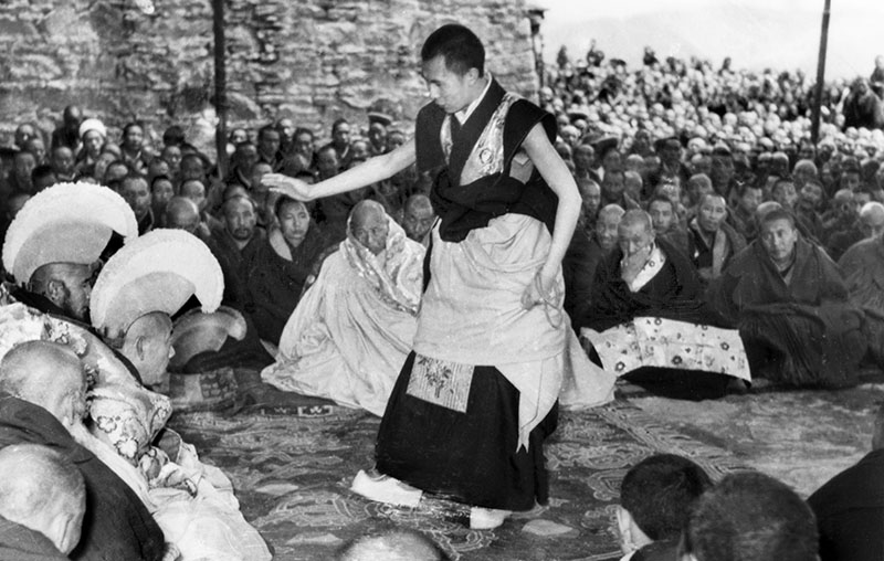 His Holiness the Dalai Lama giving Geshe Lharampa Degree (Doctorate) examination during Monlam Festival, Drepung Monastic University, Lhasa, 1959