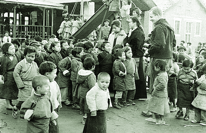Nursery children being received daily at Upper Tibetan Children's Village (TCV) School, Dharamshala at Kishore Nagar,1960