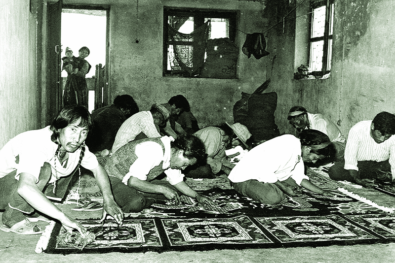 Carpets being trimmed at a Handicraft centre in a Tibetan settlements, 1979-80
