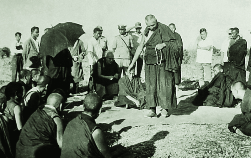 His Holiness the 14th Dalai Lama examines a philosophical debate by monks, 1960s Buxar