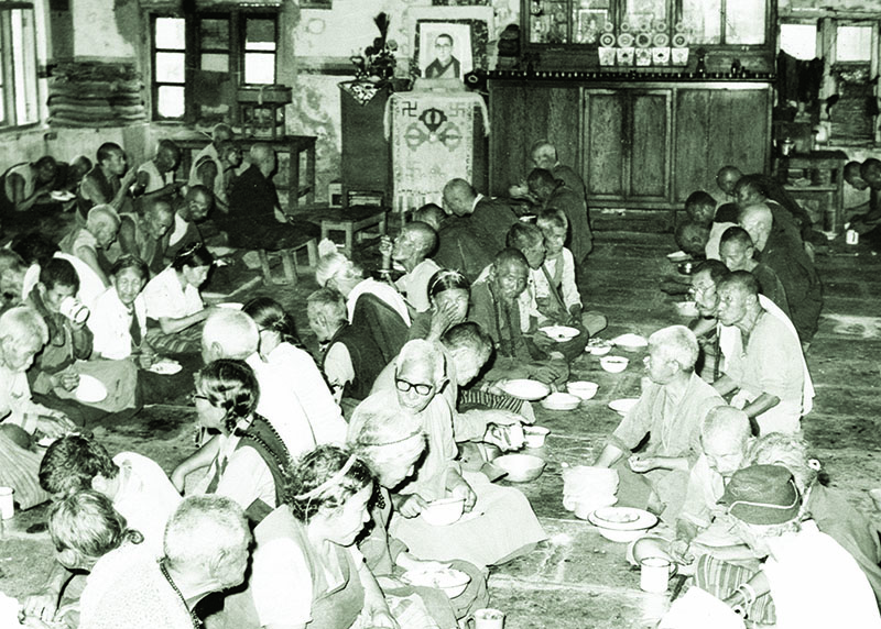 Senior Tibetans partaking their daily meal at Elderly People's Home, Mundgod