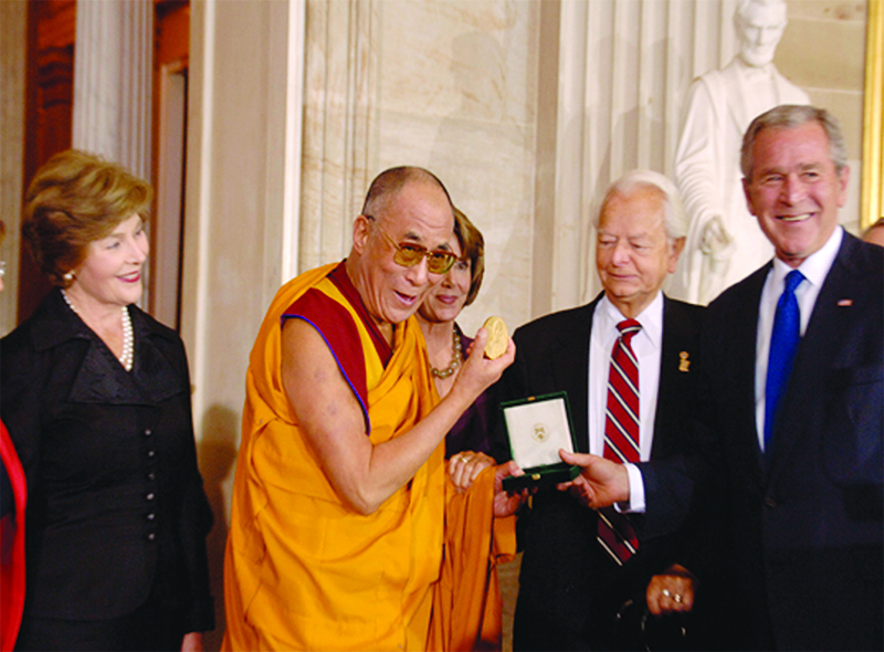 His Holiness the Dalai Lama receiving the US Congressional Gold Medal from  President Bush at the Capitol on 17 October, 2007