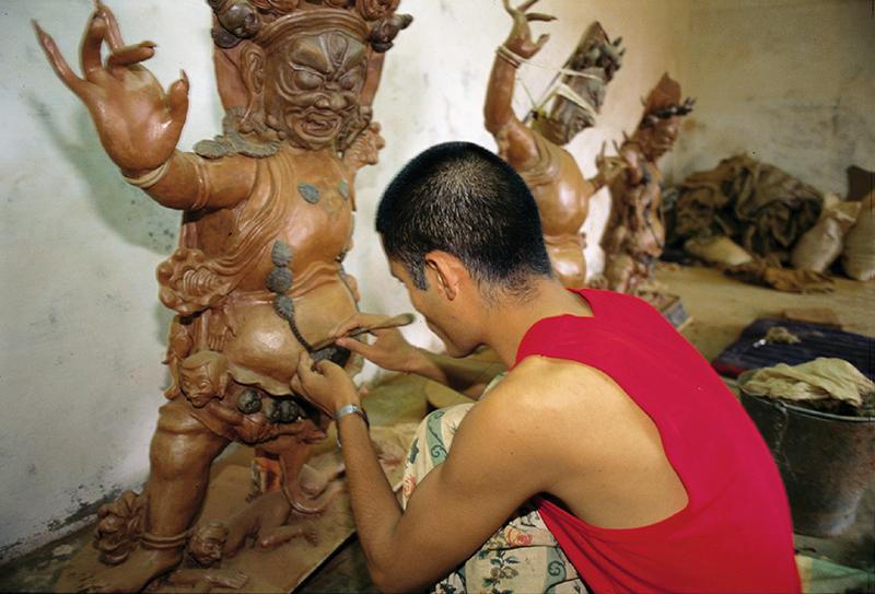 Craftsman at work, Sera Monastery, Bylakuppee settlement, Karnataka State, 1996
