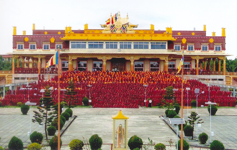 Monks of Gaden Jangtse monastery in front of the prayer hall in Mundgod, 2008