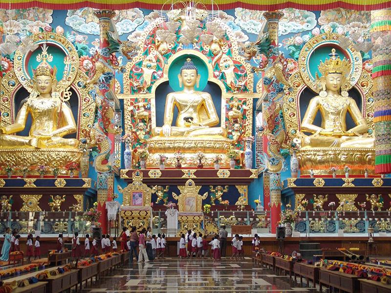 The three main divine figures inside prayer hall of Thekchok Namdrol Shedup Dargyaling monastery in Bylakuppee, Karnataka, 2005
