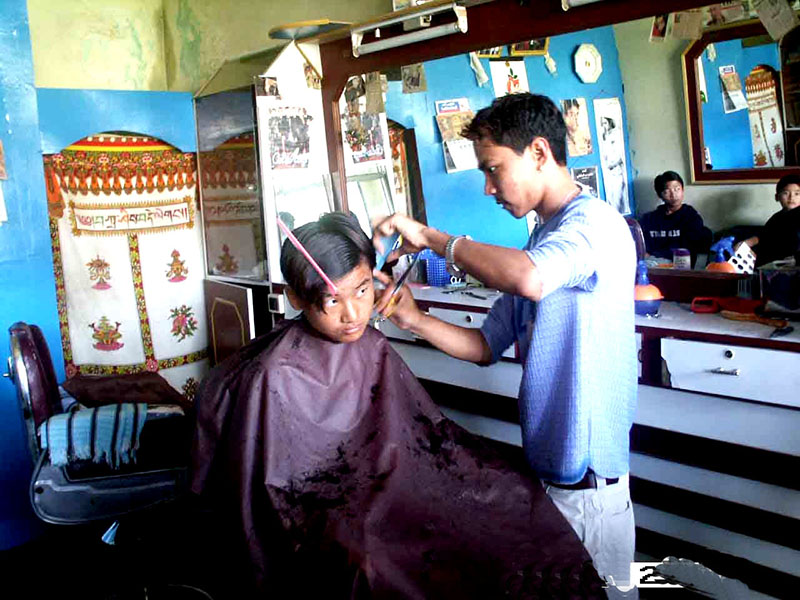 A youth running his own hair salon by availing micro-credit under Youth Empowerment Support (YES), Lugsung Samdupling, Bylakuppee