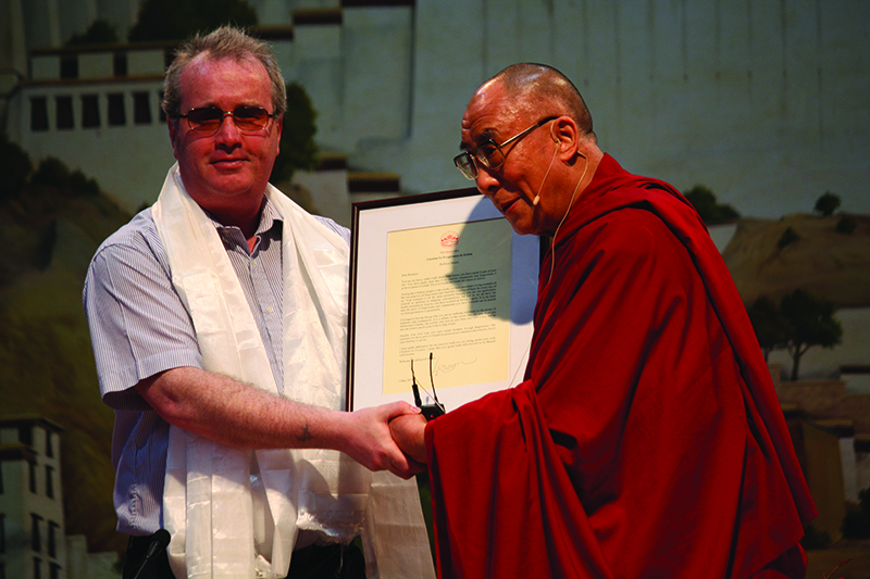"His Holiness presents a citation of honour to His Hero, Richard Moore, blinded by a rubber bullet fired by Charles (a British soldier) in 1972, and  who instead of anger and hatred, had shown compassion and befriended Charles and together they have set up  a charity for ""Children in Crossfire"" . Dharamsala 5th May 2010."
