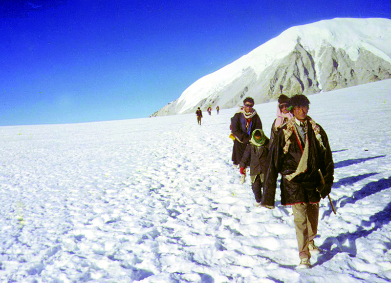 A group of Tibetans during an escape from Tibet through a high snow terrains and passes 1993