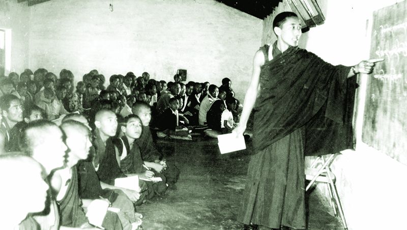 A group of newly arrived refugee monks attending a basic monastic class