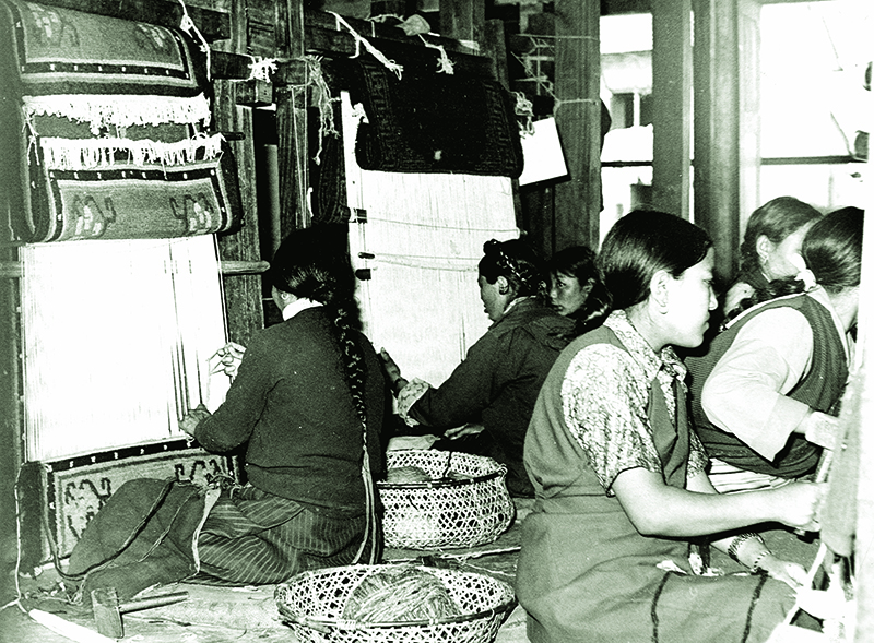 Tibetan women weaving traditional carpets in Tibetan settlements in 1979 - 80s