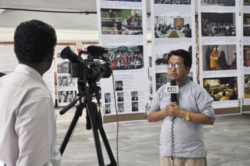 Mr Tashi Phuntsok from the Tibet Museum, speaking to a local TV channel about Tibet and the photo exhibition.