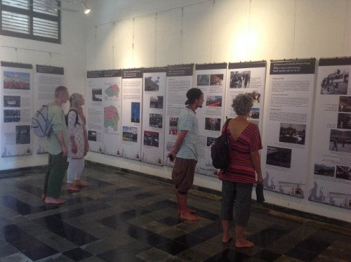 Visitors at the photo exhibition conducted by the Tibet Museum at Auroville. Photo/The Tibet Museum