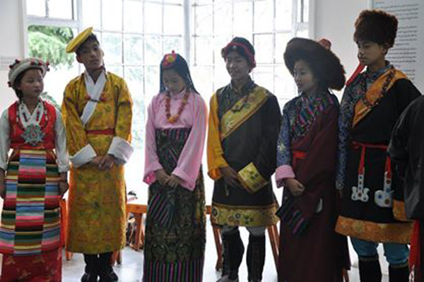 Tibetan schoolchildren showcase Tibet's traditional dresses during the celebration of international museum day at Tibet Museum in Dharamshala, India, on 18 May 2014