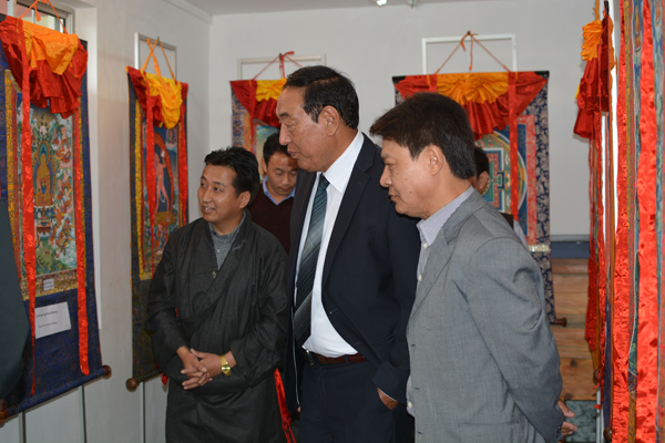 Kalon Pema Chhinjor (c) and DIIR Secretary Tashi Phuntsok look at collections of traditional paintings during the celebration of the International Museum Day at Tibet Museum in Dharamshala, India, on 18 May 2014
