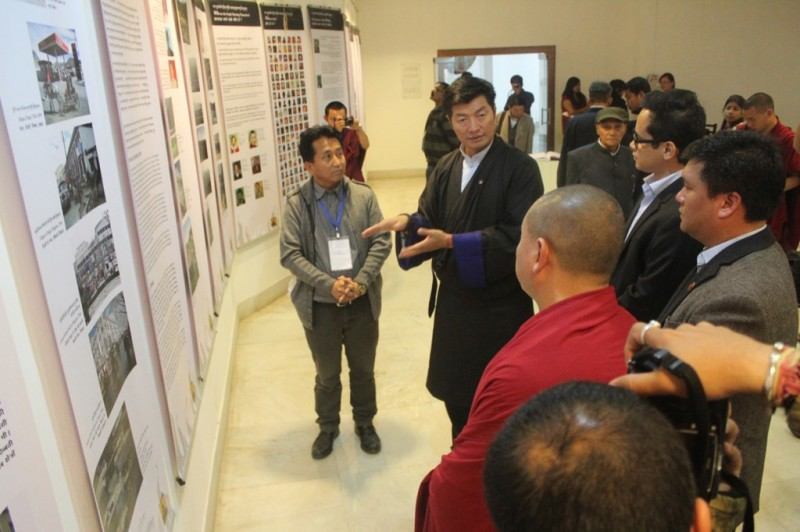 Sikyong Dr Lobsang Sangay explaining the current situation inside Tibet to the dignitaries at Tibet Museum's exhibition