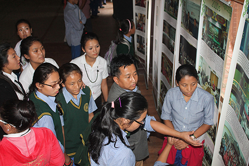 Director Tashi Phuntsok of Tibet Museum explaining His Holiness the Dalai Lama's life story and his three main commitments, to students of TCV Selakui. The exhibition is part of the '2014- Year of His Holiness the Dalai Lama' announced by the 14th Kashag