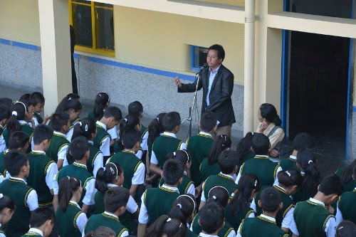 Mr. Tashi Phuntsok speaking to students of Tibetan Homes school, Rajpur