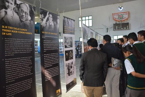 Students throng the exhibition venue to view the panels on Tibetan self-immolations