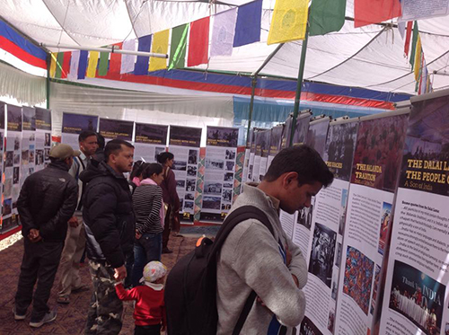 Visitors observing exhibition title India and Tibet – Ancient Ties, Current Bonds