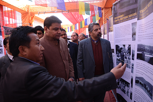 Museum's director Mr. Tashi Phuntsok guiding chief guest Mr. Sudhir Sharma to the exhibition