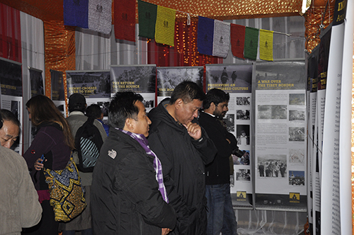 Speaker Penpa Tsering taking a look at the photo exhibition on Indo-Tibet Relations